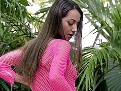 Lily Adams feels horny, so she puts her best sexy dress on and goes on the backyard, for a quick but exciting masturbation. The best thing is that her neighbor was watching her from another end of the yard, and naturally, he got instantly horny from this spectacle... Join to know more!