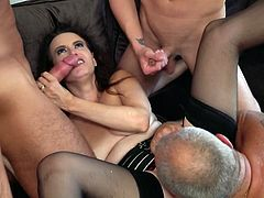 Her husband is sitting in a chair opposite and watching a group of horny men fucking his wife from all sides, and apparently, this slutty mature is really happy. Relax and enjoy impetuous group sex action!