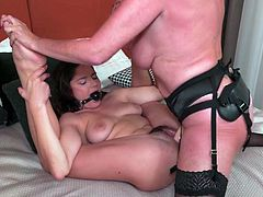 Francesca did not trust men, and therefore it was easy for Amy to catch the inexperienced babe in her lesbian nets. The slutty mature stuffed the busty babe's mouth with a ball gag and licked her hairy pussy, before fucking her with a strapon...