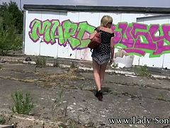 Lady Sonia is back again and exploring some more abandoned buildings while wearing a short dress and heels. She flashes her big plump tits and gives you some sexy upskirt shots so that you can see her wonderful ass!