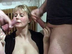Sweet milf lets 2 guys cum over her face