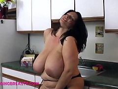 A fit woman with super big breasts