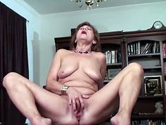 Just watch this horny mature solo scene where a naughty redhead mature slut, deep in her 50s, having fun on the leather couch at home