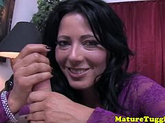 Busty office milf tugging cock with two hands while being naked
