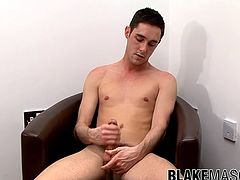 After an interview a young British man gets naked and starts masturbating before emptying his balls.